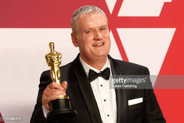 Best Film Editing winner for 'Bohemian Rhapsody' John Ottman poses in the press room at the 91st Annual Academy Awards at the Dolby Theatre in...