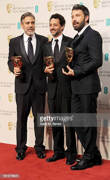 Best Film winners George Clooney, Grant Heslov and Ben Affleck pose in the Press Room at the EE British Academy Film Awards at The Royal Opera House...