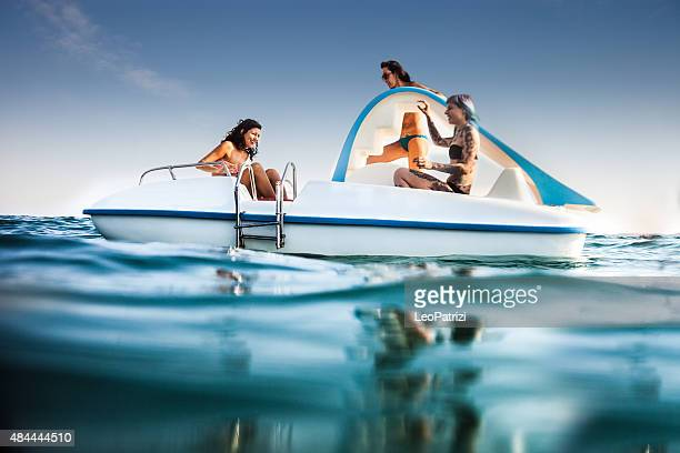 best friend enjoying summer and pedalo fun - pedal boat stock pictures, royalty-free photos & images