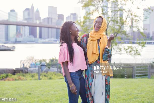 best friend #muslimgirls hanging out at the waterfront - 民族衣装 ストックフォトと画像