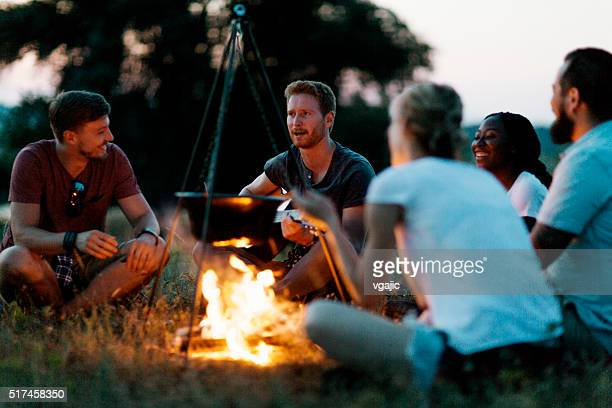 best friends camping together in nature - campfire stock pictures, royalty-free photos & images