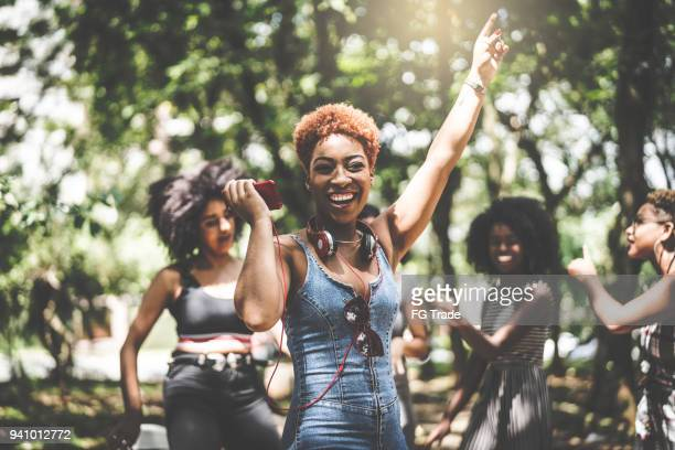 best friends dancing - black people partying stock photos and pictures