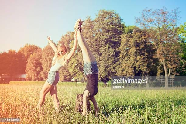 Best friends doing cartwheels in the park