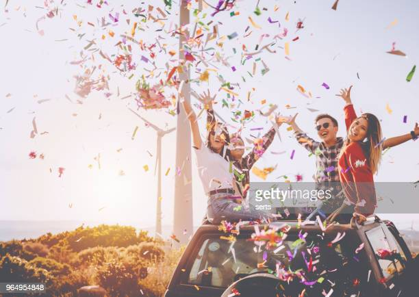 best friends enjoying the outdoor party together with colorful papers in nature - outdoor party imagens e fotografias de stock