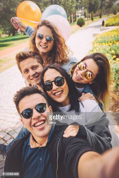 best friends having fun and taking selfie at park - vertical stock pictures, royalty-free photos & images