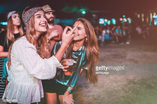 best friends having fun at the summer music festival - nightlife stock pictures, royalty-free photos & images