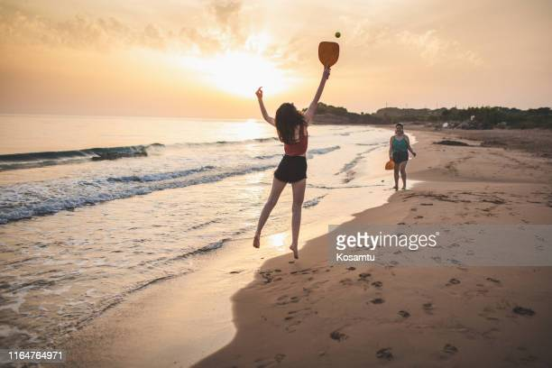 best friends having fun on summer vacation - racquet stock pictures, royalty-free photos & images