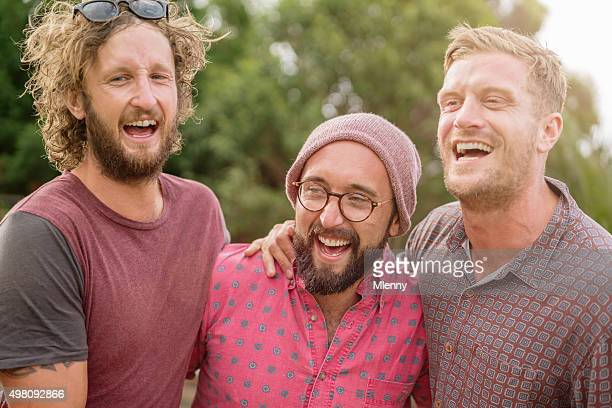best friends laughing and joking around at outdoor party - male friendship stock pictures, royalty-free photos & images