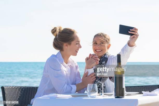 best friends celebrating beach make selfie