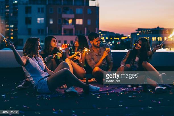 best friends on a rooftop party - roof stock pictures, royalty-free photos & images