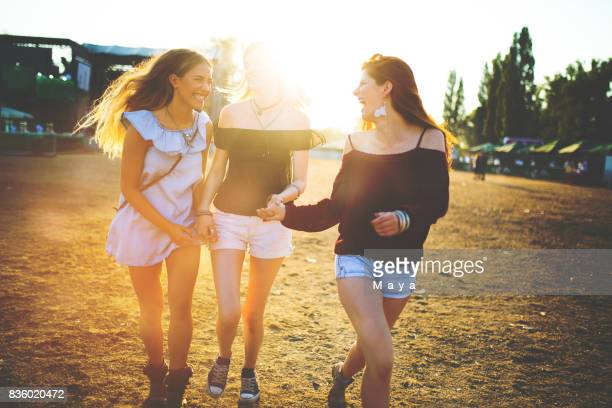 best friends on summer festival - festival goer stock pictures, royalty-free photos & images