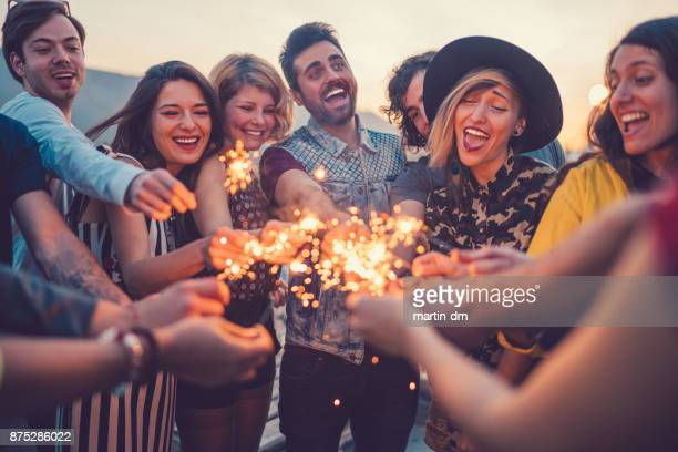best friends partying on rooftop - 18 19 years stock pictures, royalty-free photos & images
