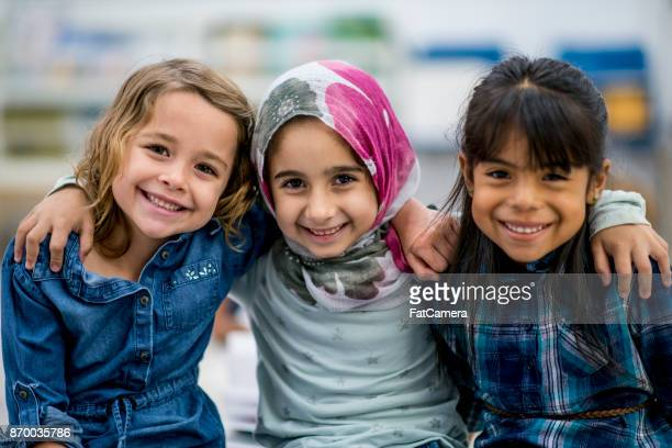 best friends - muslim boy stock photos and pictures