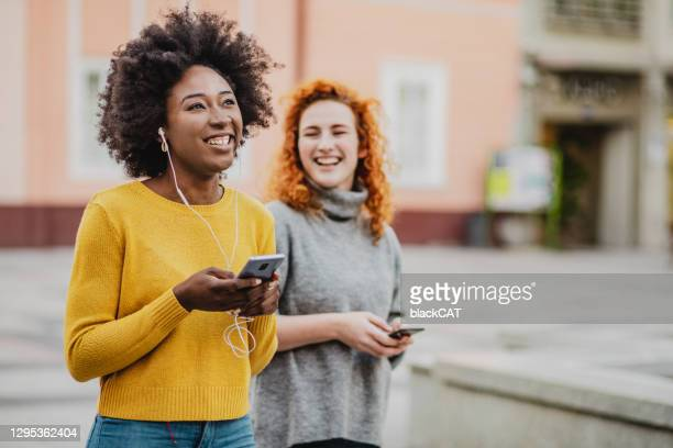 best friends spend time together in the city - friendly match stock pictures, royalty-free photos & images
