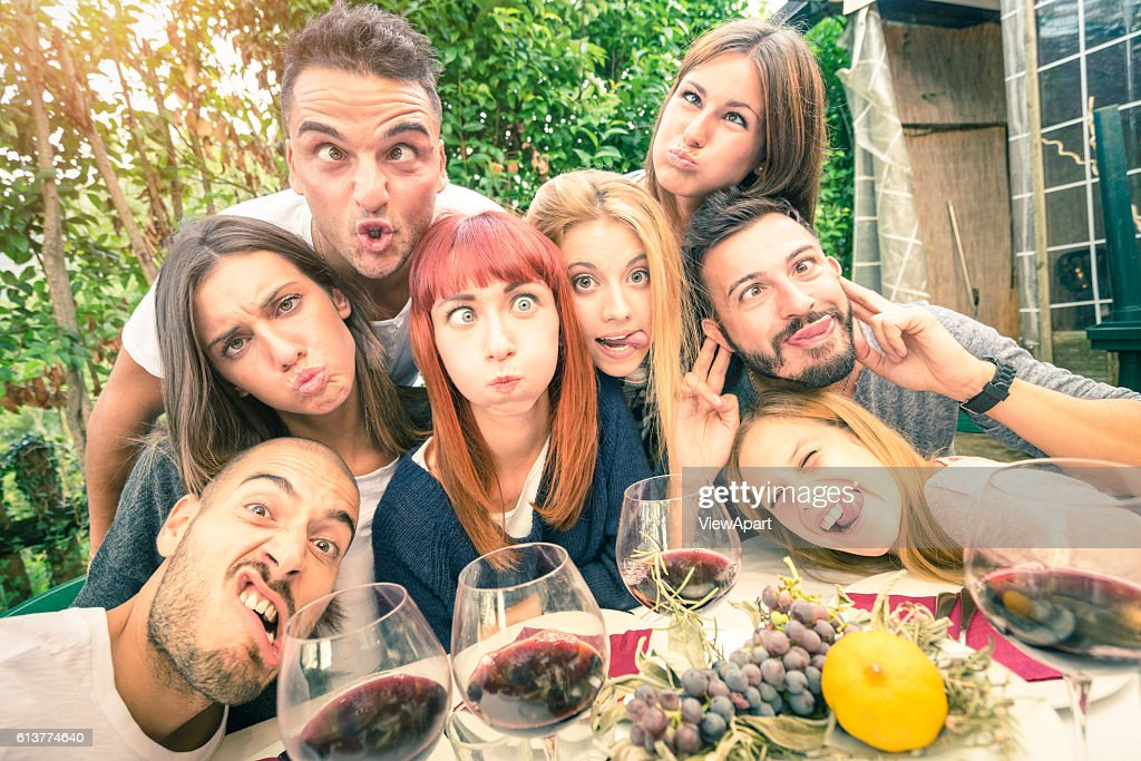 Best friends taking selfie outdoor at winery tasting wine : Stock Photo