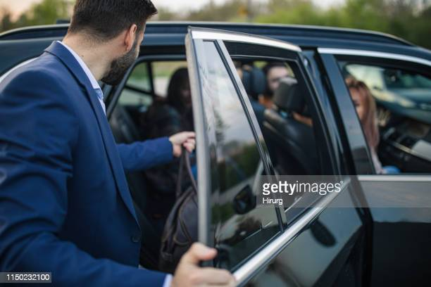best friends traveling by a car - entering stock pictures, royalty-free photos & images