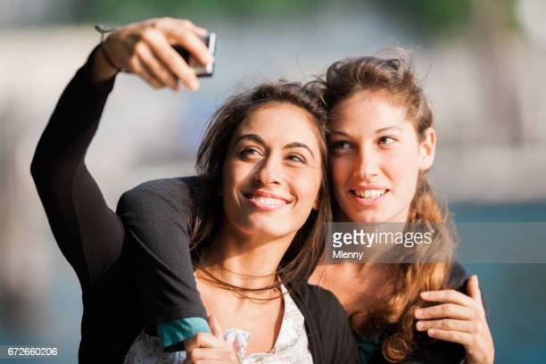 best friends, young women taking selfies in their vacation - mlenny stock pictures, royalty-free photos & images