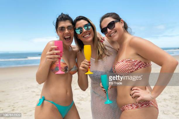 best girlfriends on celebratory toast at beach - natal brazil stock pictures, royalty-free photos & images