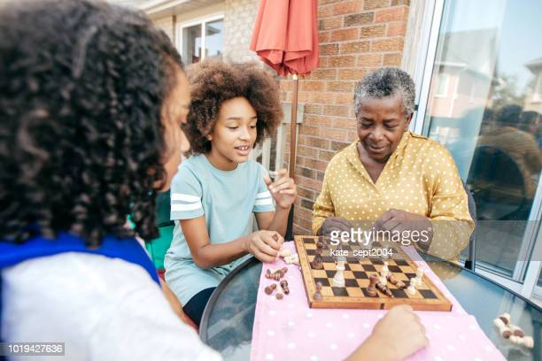 best grandmother and siblings - game board stock photos and pictures