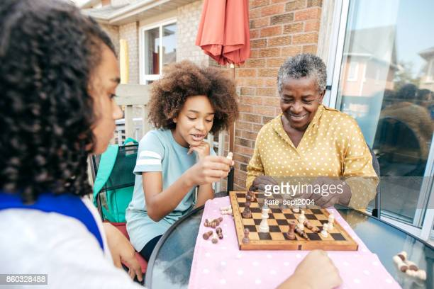 best grandmother and siblings - game night leisure activity stock pictures, royalty-free photos & images