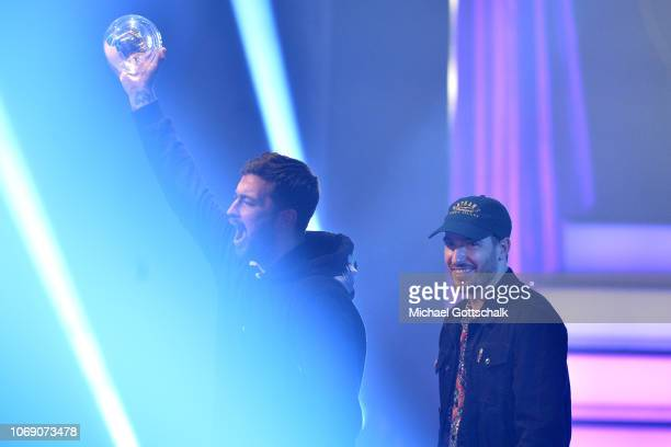 'Best HipHop Act' award winner Marteria and Casper speak on stage at the 1Live Krone radio award at Jahrhunderthalle on December 6 2018 in Bochum...