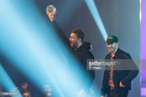 'Best HipHop Act' award winner Marteria and Casper speak on stage at the 1Live Krone radio award at Jahrhunderthalle on December 6 2018 in Bochum...