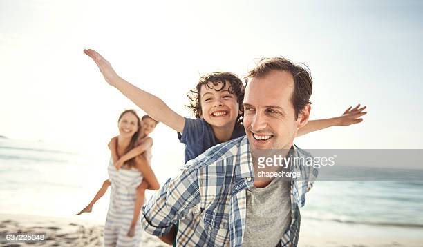 best holiday ever! - candid beach stock photos and pictures