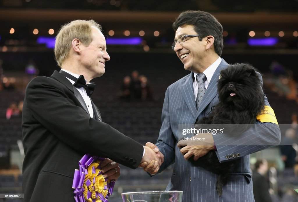 Best in Show judge Michael Dougherty (L), congratulates dog handler Ernesto Lara after his dog Banana Joe, an Affenpincher, won the 137th Westminster Kennel Club Dog Show on February 12, 2013 in New York City. A total of 2,721 dogs from 187 breeds and varieties competed in the event, hailed by organizers as the second oldest sporting competition in America, after the Kentucky Derby.