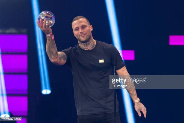 'Best Live Act' Award winner Kontra K poses on stage at the 1Live Krone radio award at Jahrhunderthalle on December 6 2018 in Bochum Germany