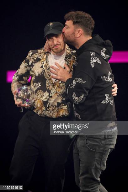 'Best Live Act' award winners Casper and Marteria are seen on stage at the 1Live Krone radio award at Jahrhunderthalle on December 05 2019 in Bochum...