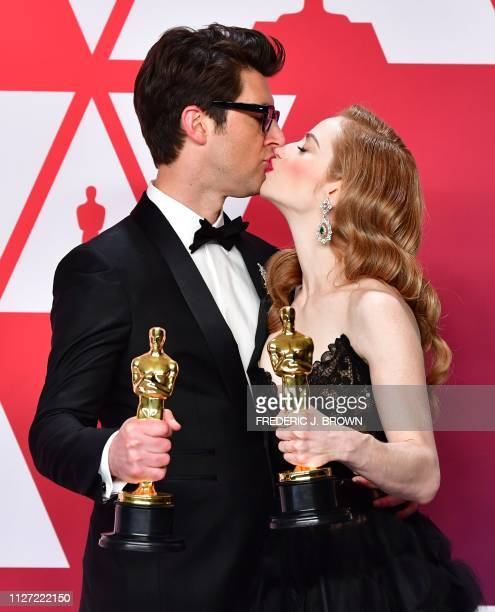 TOPSHOT Best Live Action Short Film winners for Skin Director Guy Nattiv and his wife actress Jaime Ray Newman kiss in the press room with their...