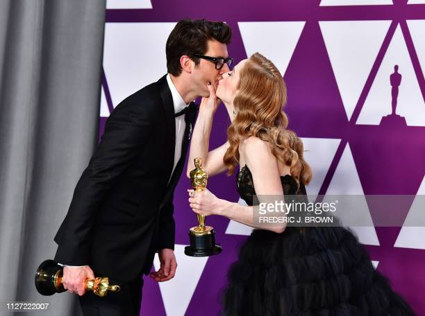 Best Live Action Short Film winners for Skin Guy Nattiv and his wife Jaime Ray Newman kiss in the press room with their Oscar during the 91st Annual...