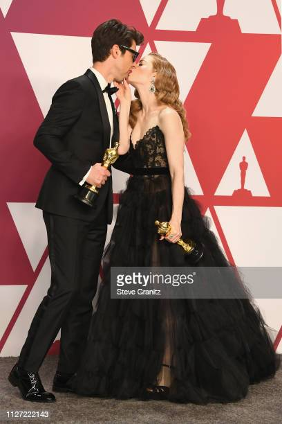 Best Live Action Short Film winners for 'Skin' Guy Nattiv and Jaime Ray Newman kiss poses in the press room during at Hollywood and Highland on...