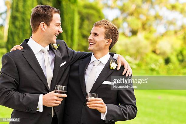 Best Man And Groom With Whisky Glasses In Garden