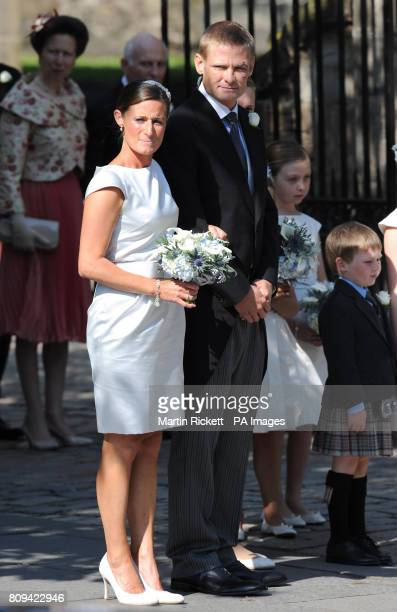 Best man Iain Balshaw and Maid of Honour Dolly Maude are seen outside Canongate Kirk Edinburgh after the wedding of Zara Phillips and Mike Tindall