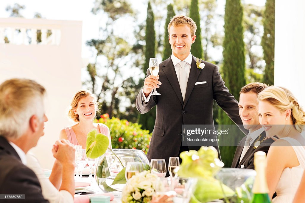 Best Man Raising A Toast During Wedding Reception Stock Photo