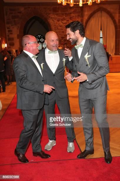 Best man Stephan Ohneck Stefan Richter and Tom Beck during the church wedding of Erdogan Atalay and Katja Ohneck at Heidelberg Castle on September 30...