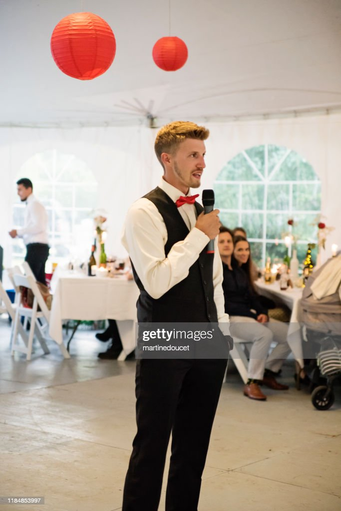 Best man's speech at the table of honour at wedding reception. : Stock Photo