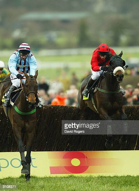Best Mate ridden by Jim Culloty leads over the final fence from Harbour Pilot ridden by Paul Carberryis during the Totesport Cheltenham Gold Cup held...