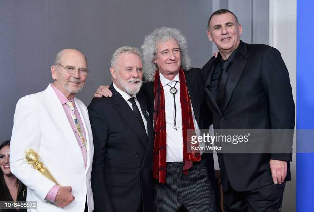 Best Motion Picture Drama Award Winners for 'Bohemian Rhapsody' producers Jim Beach Graham King and Brian May and Roger Taylor of Queen pose in the...