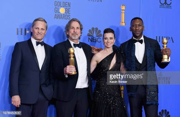 Best Motion Picture Musical or Comedy award for 'Green Book' winners Viggo Mortensen Peter Farrelly Linda Cardellini and Mahershala Ali pose in the...