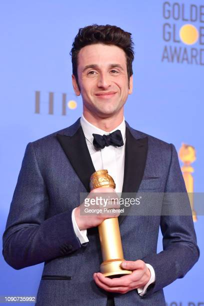 Best Original Score Motion Picture for 'First Man' winner Justin Hurwitz poses in the press room during the 75th Annual Golden Globe Awards held at...