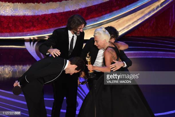 TOPSHOT Best Original Song nominees for Shallow from A Star is Born Lady Gaga Mark Ronson Anthony Rossomando and Andrew Wyatt accept the award for...