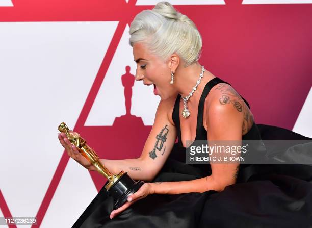 TOPSHOT Best Original Song winner for Shallow from A Star is Born Lady Gaga poses in the press room with the Oscar during the 91st Annual Academy...