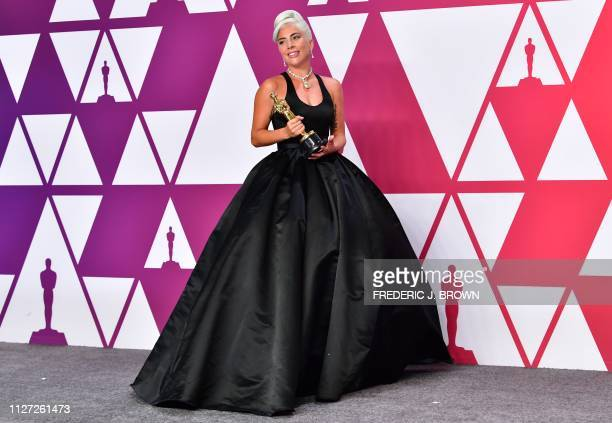 Best Original Song winner for Shallow from A Star is Born Lady Gaga poses in the press room with the Oscar during the 91st Annual Academy Awards at...