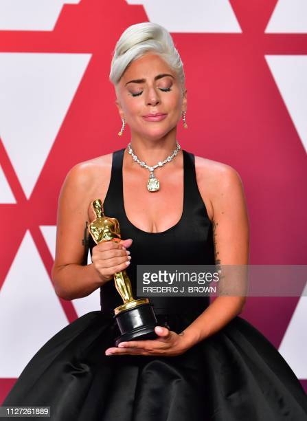 TOPSHOT Best Original Song winners for Shallow from A Star is Born Lady Gaga poses in the press room with the Oscar during the 91st Annual Academy...