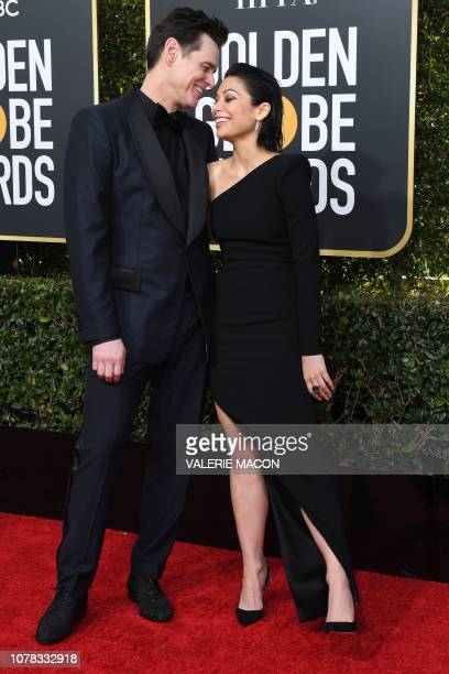 Best Performance by an Actor in a Television Series Musical or Comedy for Kidding nominee Jim Carrey and US actress Ginger Gonzaga arrive for the...