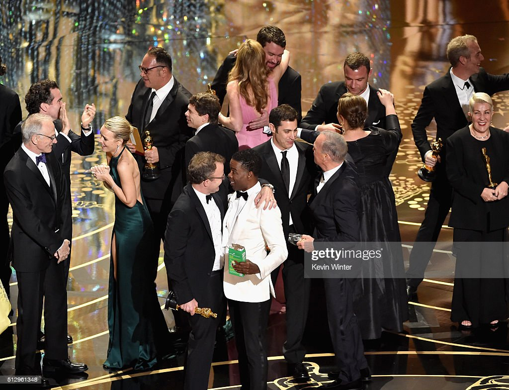 Best Picture winner 'Spotlight' cast and crew including actress Rachel McAdams, producer Michael Sugar, director Tom McCarthy, screenwriter Josh Singer and actor Michael Keaton, actor Liev Schreiber, and host Chris Rock (C) celebrate onstage during the 88th Annual Academy Awards at the Dolby Theatre on February 28, 2016 in Hollywood, California.