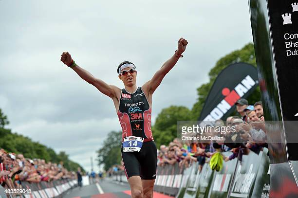 Best placed Irish athlete Kevin Thorton as crosses the finish line during the Ironman triathlon event on August 9 2015 in Dublin Ireland More than...