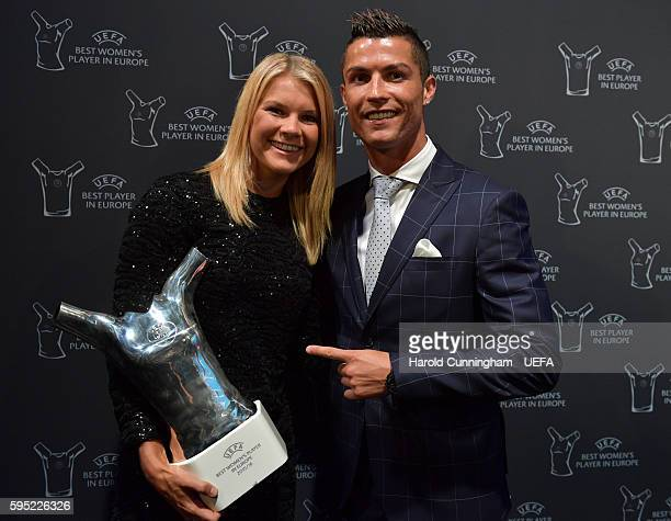 Best Player in Europe Award winner Christiano Ronaldo and UEFA Best Women's Player in Europe Award winner Ada Hegerberg pose during the ECF Season...
